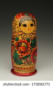 Wooden Matrioshka from Russia in a grey background