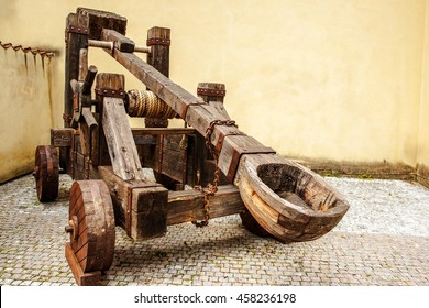 Wooden Medieval Catapult Ballistic Device. Ancient Military Technology