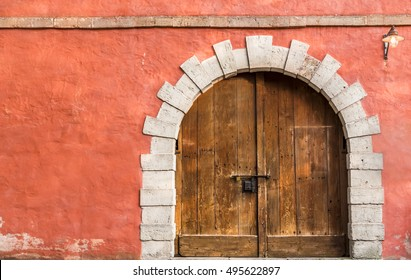 Wooden medieval door and orange wall - Medieval architecture background with a massive wooden door and & Medieval Door Images Stock Photos u0026 Vectors | Shutterstock