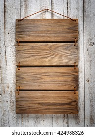 wooden menu board on aged white wooden wall