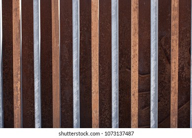 Wooden and metal slats. Parallel straight lines.