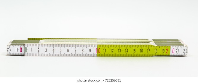 A wooden meter on a white background