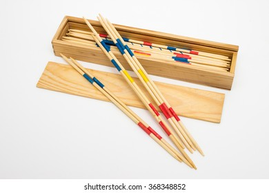 Wooden Mikado sticks and box isolated on white