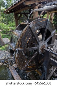 the wooden mill wheel which flows like water and it turns