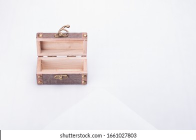 A wooden mini wooden crate with latch isolated over white