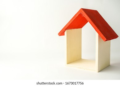 wooden mini house on the white background as business, family and property concept