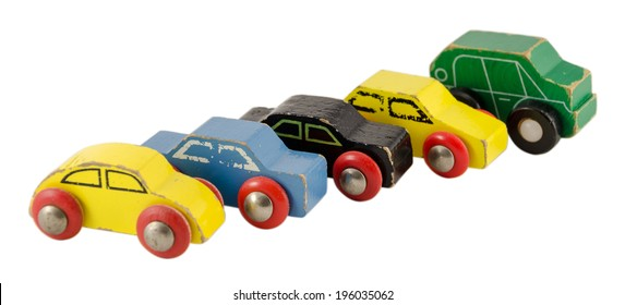 wooden miniature colorful car toy in row isolated on white background