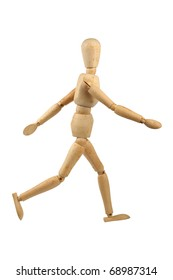Wooden model dummy in walking position. Isolated on a white background.