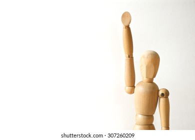 Wooden model raise his hand on white background