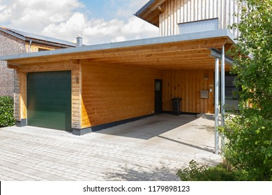 wooden and modern carport in south germany bavarian village area