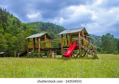Wooden modern children playground in nature park