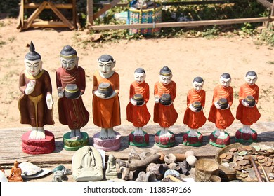 Wooden monks with alms wood carving from wood at Mondalay Myanmar