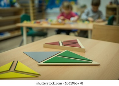 Wooden Montessori toys on table in kindergarten