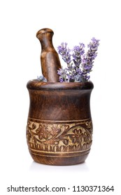 Wooden mortar with lavender flowers isolated on white background