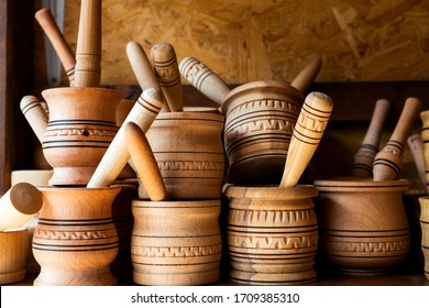 wooden mortar with pestle on a shelf