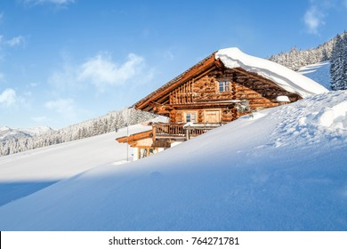 Wooden mountain chalet lodge in the alps in winter