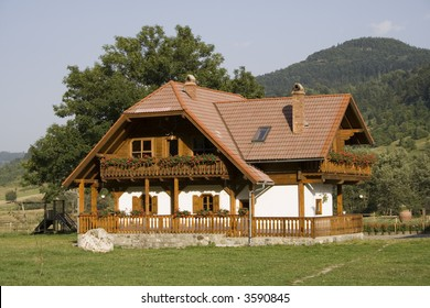 Wooden mountain house in summer time