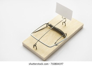 wooden mousetrap on white background with blank signboard
