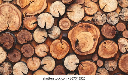 Wooden natural cut logs textured background, top view, flat lay