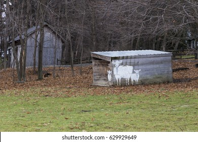 Wooden natural wood shed with sheep painting