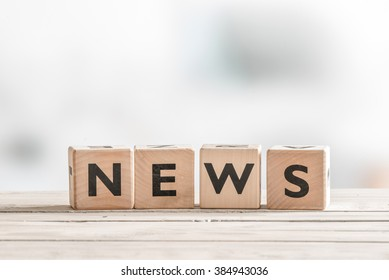 Wooden news sign on a table in an office
