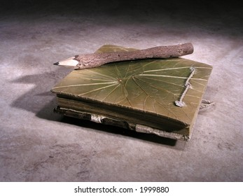 Wooden notebook with pencil