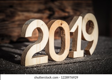 Wooden number 2019 on wooden background. Happy new Year 2019.