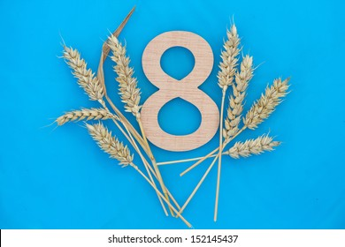 wooden number 8 with wheat ears