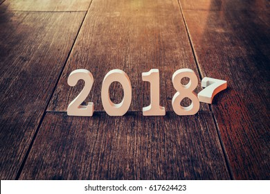 Wooden numbers forming the number 2018, For the new year 2018 on a rustic wooden background.