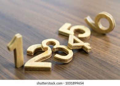 wooden numbers on wooden table