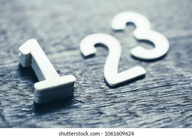 Wooden numbers for ranking concept, closeup at number one with shallow depth of field