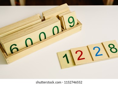 Wooden numbers in tables to learn mathematics in a Montessori classroom.