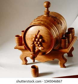 Wooden oak wine barrel with tap and mug