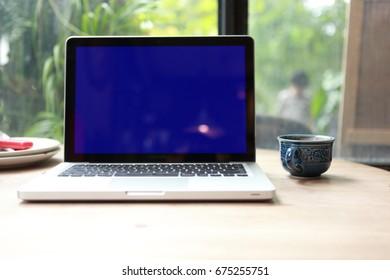 wooden office desktop with tablet