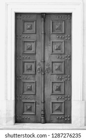 Wooden old catholic church door. Converted black and white.