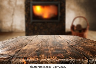 wooden old table place and fireplace