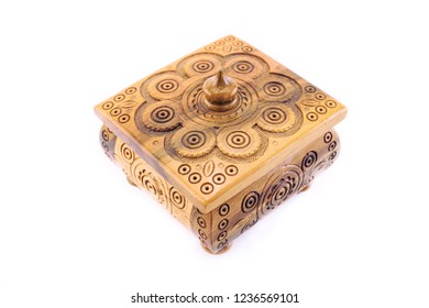 wooden old vintage handmade jewelry box casket with threaded patterns isolated on white background