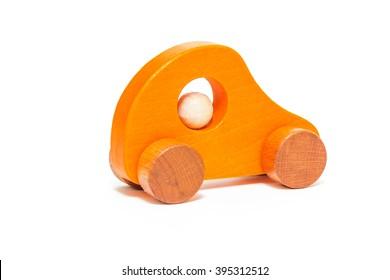 Wooden orange toy car isolated on white background.