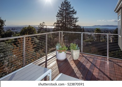 Wooden outdoor deck balcony with Stainless Steel Square Post Cable Rail System