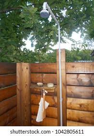 Wooden outdoor shower at a Finnish summerhouse