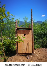 wooden outhouse built in nature