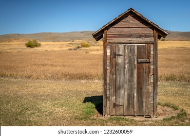 Wooden outhouse on the edge of a farmer's field in Idaho