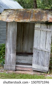 WOODEN OUTHOUSE OPEN FOR BUSINESS