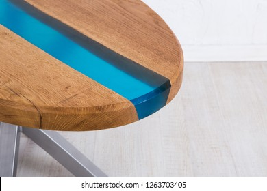 Wooden oval table in the style of living edge imitating the middle of the river