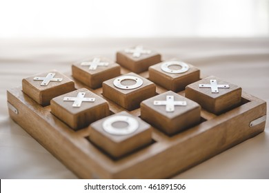 Wooden OX game on marble
