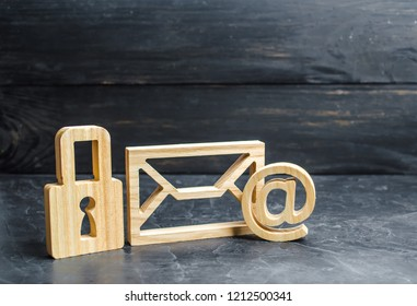 Wooden padlock stands next to the email envelope. concept of protection of personal data trade secrets, dedication to secrets. Preservation of secrets. Bank secrecy. Protection of information networks