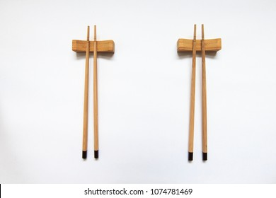 Wooden pairs of chopsticks on white background. space for text, image, advertisement. cooking culture in Asian countries.