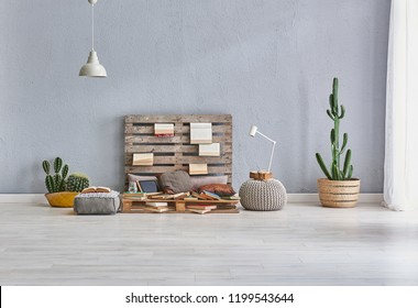 Wooden pallet decor and many book style. Green stone wall puff and bike concept. home decoration interior style.
