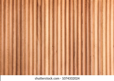 Wooden panel from the slats. Texture of cylindrical wooden slats. Beautiful wooden background.