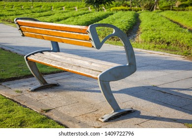 Wooden park bench at sunrise in a park,Fuzhou,China